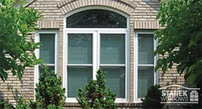 Stanek Windows with white trim on a white brick house