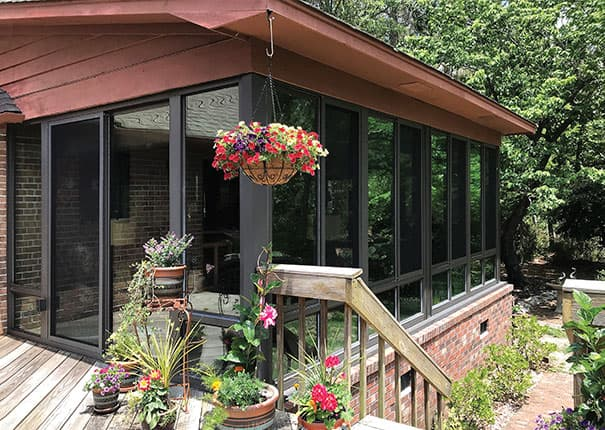 Patio enclosures sunrooms custom designed sunrooms for Backyard sunroom